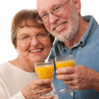 Happy Senior Couple with Orange Juice — Stock Photo