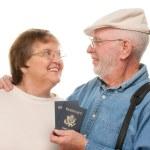 Happy Senior Couple with Passports — Stock Photo #2354891