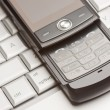 Abstract Cell Phone on Laptop Macro Image. — Stock Photo