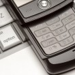 Abstract Cell Phone on Laptop Macro — Stock Photo