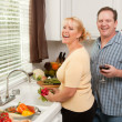 Stock Photo: Happy Couple Enjoying Food Preparation