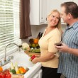 Happy Couple Enjoying Food Preparation — Stock Photo #2355274