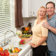Happy Couple Enjoying Food Preparation - Stock Photo