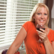 Attractive Blond with a Glass of Wine - Stock Photo