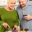 Couple Drinking Wine in the Kitchen — Stockfoto