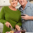 Couple Drinking Wine in the Kitchen — Stock Photo #2355418