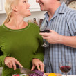 Couple Drinking Wine in the Kitchen — Stock Photo #2355420