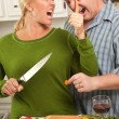Man Gets too Close To Wife Cutting Food — Stock Photo