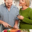 Couple Drinking Wine in the Kitchen — Stock Photo #2355435