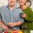 Couple Drinking Wine in the Kitchen - Stock Photo