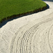 Abstract of Sand Bunker and Grass on Golf Course - Stock Photo