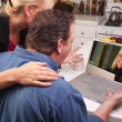 Couple Using Laptop with Woman on Screen — Stock Photo
