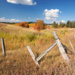 Royalty-Free Stock Photo: Beautiful Fall Landscape with Rustic Fence