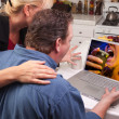 Stock Photo: Couple Using Laptop with Money on Screen
