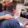 Royalty-Free Stock Photo: Couple Using Laptop with Money on Screen