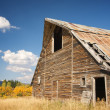 Royalty-Free Stock Photo: Rustic Barn Scene with Deep Blue Sky and Clouds