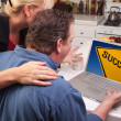 Couple In Kitchen Using Laptop with Yellow Success Sign on Screen — Stock Photo