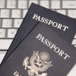 Two Passports on a Laptop Computer - Stockfoto