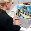 Woman In Kitchen Using Laptop with Las Vegas Sign on Screen — Stock Photo #2357314