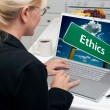Woman In Kitchen Using Laptop with Ethics Road Sign on Screen — Stock Photo