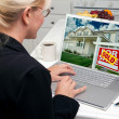 Woman In Kitchen Using Laptop to Research Real Estate — Stock Photo #2357549