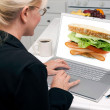Girl Using Laptop, Sandwich on Screen — Stock Photo