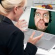 Girl Using Laptop with Man on Screen — Stock Photo #2357705