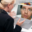 Shocked Woman In Kitchen Using Laptop with Strange Man on Screen — Stock Photo
