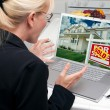 Excited Woman In Kitchen Using Laptop to Sell or Buy a Home — Stock Photo