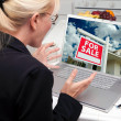 Stock Photo: Excited WomIn Kitchen Using Laptop to Buy House