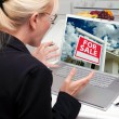 Excited Woman In Kitchen Using Laptop to Buy a House — Stock Photo