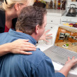 Couple In Kitchen Use Laptop to Research — Stock Photo #2357830