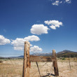 Aged Fence and Clouds - Stock Photo