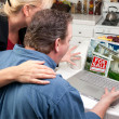 Couple In Kitchen Using Laptop to Research Real Estate — Stock Photo #2357867