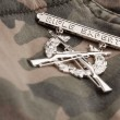 Rifle Expert War Medal on Camouflage - Stock Photo