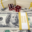 One Hundred Dollar Bills and Red Dice - Stockfoto