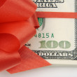 Royalty-Free Stock Photo: One Hundred Dollar Bills Wrapped in Red
