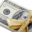 Stack of U.S. Money Wrapped Gold Bow — Stock Photo