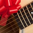 Guitar Close-up with Red Ribbon Bow — Stockfoto