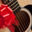 Guitar and Strings with Red Ribbon — Stock Photo