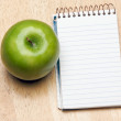 Pad of Paper and Apple on Wood — Stock Photo