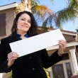 House and Woman Holding Blank Sign — Stock Photo