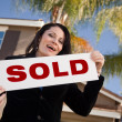 ������, ������: Happy Hispanic Woman Holds SOLD Sign