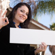Happy Hispanic Woman Holds Blank Sign — Stock Photo #2358553