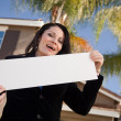 Front of House, Lady with Blank Sign — Stock Photo #2358560