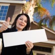 Front of House, Lady with Blank Sign — Stock Photo #2358569