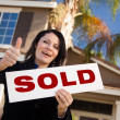 Hispanic Woman and Sold Real Estate Sign — Stock Photo #2358583