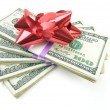 Stack of Money with Bow Isolated on Whit - Stock Photo