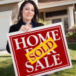 House and Woman Holding Sold Home Sign — Stock Photo