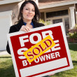 House and Woman Holding Sold Sign — Stock Photo #2358627
